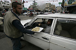 Palestinians distribute desserts celebrating the attack at the Jewish settlement of Itmar near Nablus in Rafah on March 12, 2011. A Palestinian infiltrated Itamar early Saturday and killed five people, the Israeli military said. Photo by Abed Rahim Khatib